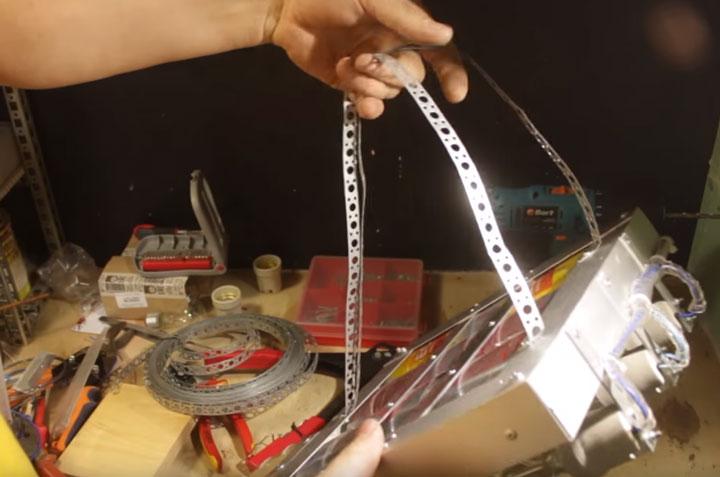 подвеска инфракрасного обогревателя за перфоленту для регулировки угла наклона