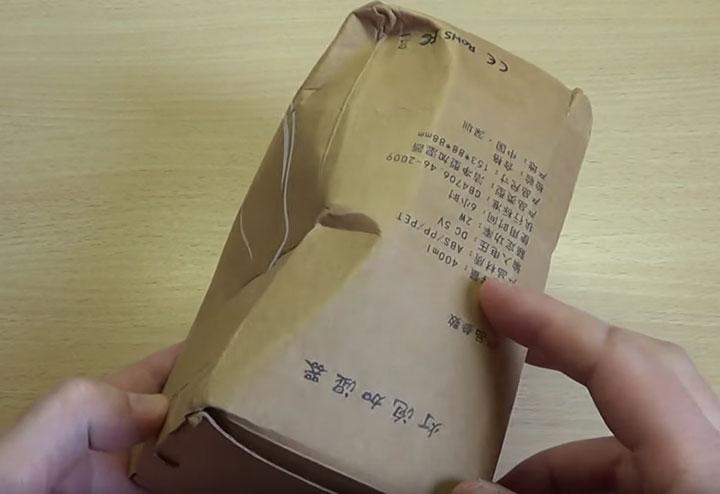 помятая упаковка от лампочки увлажнителя