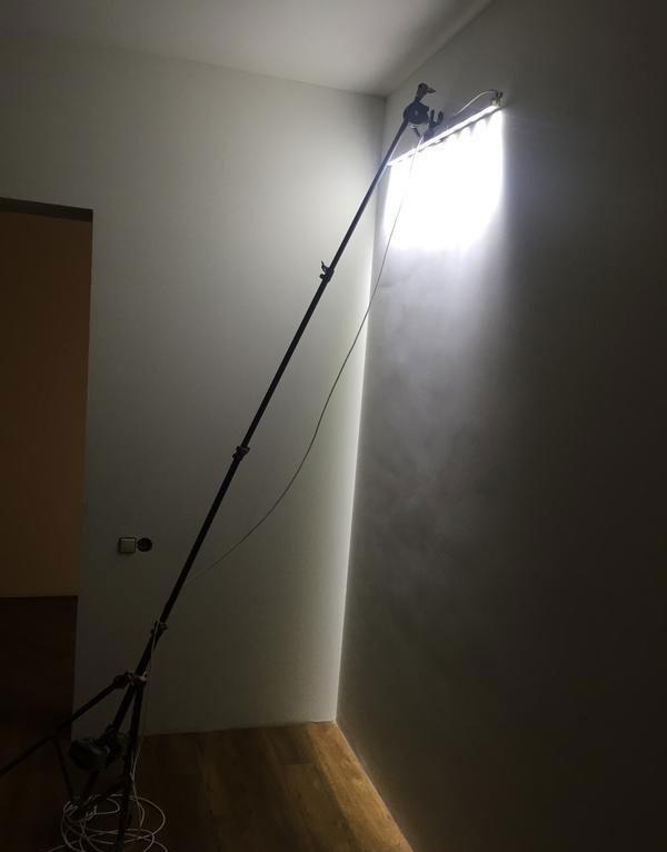 засветка лампой маляра стены при отделке