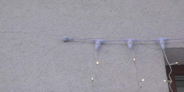 как закрепить гирлянду на фасаде стены дома