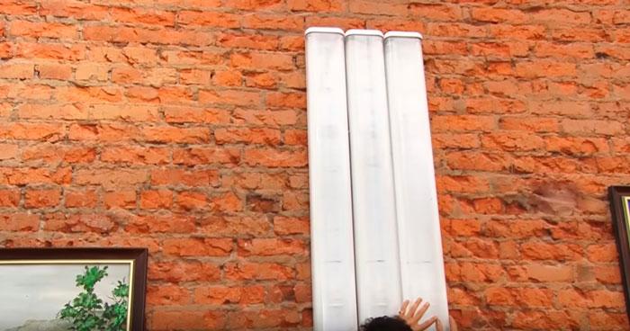 закрепление ламп дневного света филипс на стене в художественной мастерской