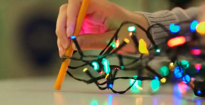 разматывание узелков на гирлянде ручкой